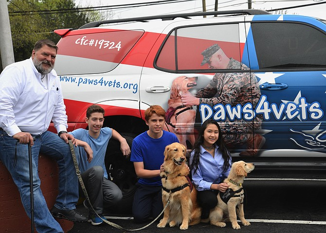 From left, paws4vets client, and now a Relationship Development Officer for the paws4people foundation, Randy Powers attended the DEL Donates-organized fundraiser with his canine partner MORGAN. DEL Donates founder Dylan Kurtz of Great Falls, and Kilmer Middle School classmates and fellow philanthropists Evan Preta [with MORGAN] and Lara Jae Evangelista [with SILAS].
