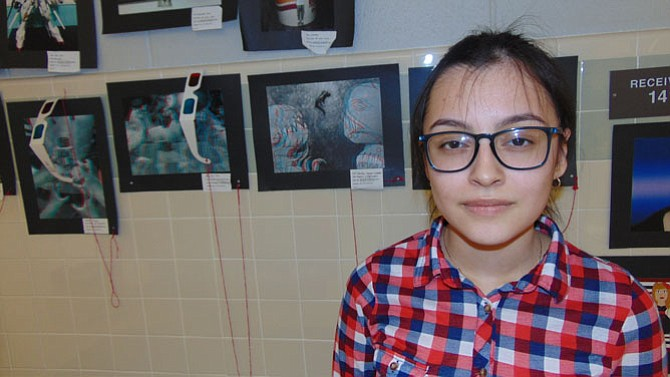 "Jennifer Vasquez-Campos of Springfield, a 10th grader at Lee High, with her ""Dreams and Nightmares"" artwork."