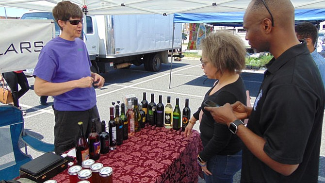 Celeste Kenny of Fabioli Cellars of Loudoun County offers samples of wine.