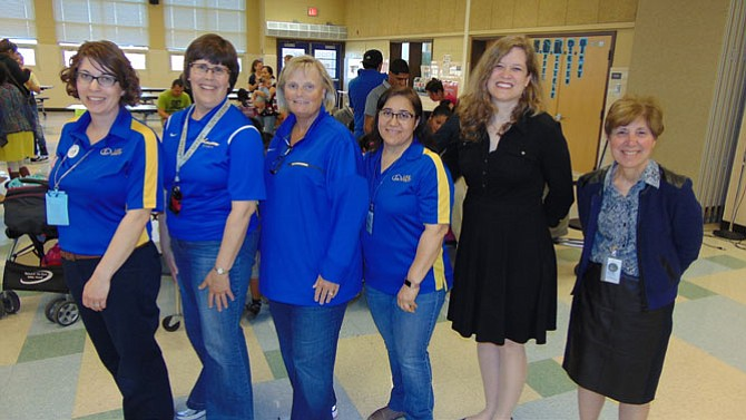 From left: Lisa Koch, Lee High Librarian; Mimi Marquet, Lee High Head Librarian; Deirdre Lavery, Principal of Lee High School; Lourdes Salas, Administrative Assistant; Priscille Dando, Coordinator of Library Information Services with Fairfax County; and Denise Katz, Assistant Principal at Lee.