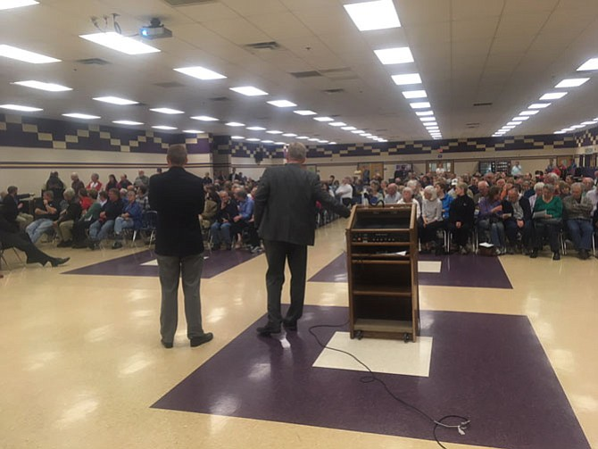 Supervisors John Cook (R-Braddock) and Jeff McKay (D-Lee) addressed a cafeteria at Lake Braddock that was packed with Lake Accotink fans.