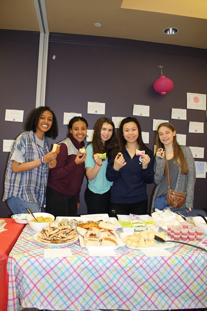 From left: Afomiya Alemay, Maraki Fanuil, Sophia Powell, Brittany Peng and Rachel Friedman display international foods at the event.