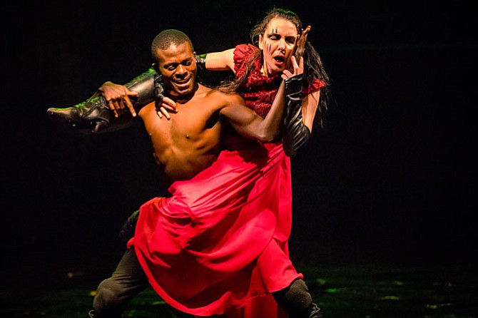 "Audrey Tchoukoua (Aaron) and Irina Tsikurishvili (Tamora Queen of the Goths) star in Synetic Theater's production of ""Titus Andronicus."""