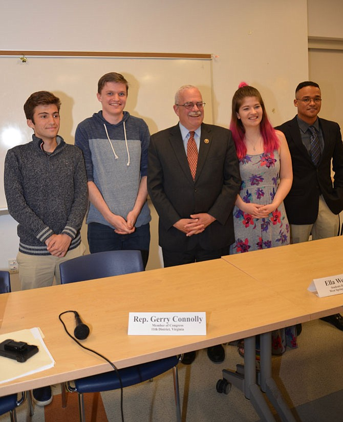 Local student activists called for a meeting with their congressman, U.S. Rep. Gerry Connolly (D-11), who responded with a Town Hall event. Flanking Connolly are, left, Ryan Carney, Madison High School junior, and Michael McCabe, Robinson Secondary School sophomore. On right are Ella Wogaman, West Springfield High School senior and Langston Carter, senior from Woodbridge.