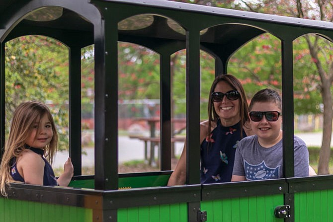 Sherean Miller, with her two children, Seaton and Kennedy, came all the way from Arlington to ride the train Saturday morning. They come to the park often and love riding the train and the carousel.