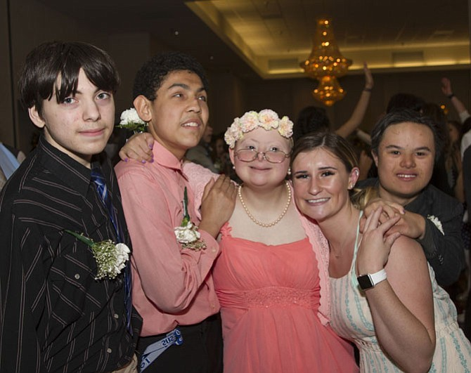 Robinson students Charlie Serbia, Anthony Palma, Maria Danner, Macey Dunn, and Sean Pulju have a great time dancing together.