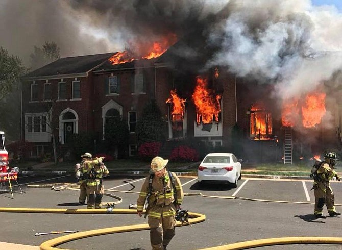 Flames and firefighters at the townhouses in Sully Station II.