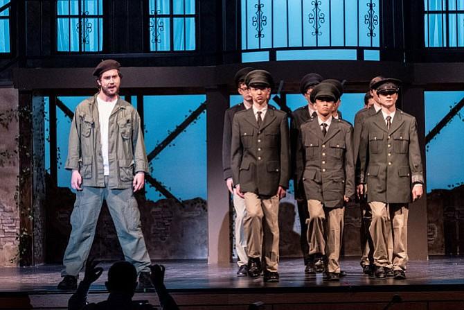 From left:  Mark Bosset, Peter Fox, Leland Hao, Samuel Buroker in Langley High production of 'Evita.'