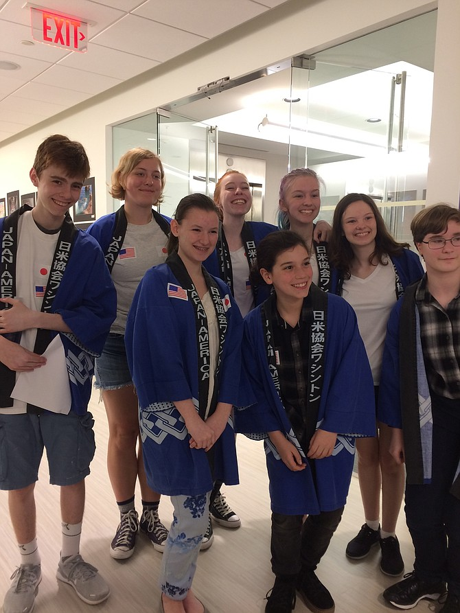 From left: Conor Hogan, Allison Lee, Juliana Logan, Winnie Brent, Liam Mason, Cate Hogan, Mary Bennett, and Cordelia Medrick advocate for world languages at May 3 School Board meeting.