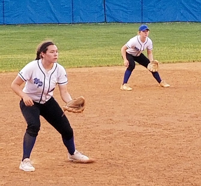 Third baseman Jennavieve Miller, left, and shortstop Katie Jo Moery are two of the West Potomac softball team's top producers.