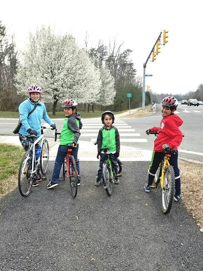 "Enjoying 9.6 Miles of Burke: Jorge Torrico of Burke writes: ""My beautiful wife Yoonji and my sons, Peter, Daniel and Paul, surprised me with a wonderful family bike ride to dinner and back, enjoying 9.6 miles of Burke."""