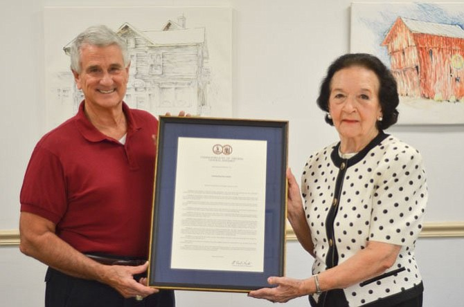 In August 2014, then-Delegate Tom Rust (R-86) presents a resolution recognizing lifelong Herndon resident Elma Mankin, who turned 90 that month.
