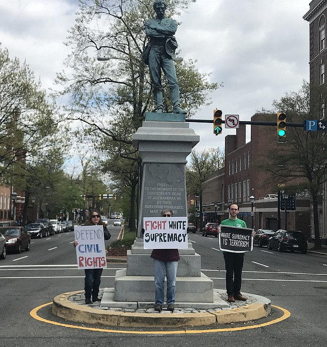 Members of Grassroots Alexandria in front of the Confederate monument in Old Town.