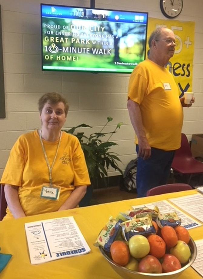 Robert King and Vera Liberu direct visitors to the senior activities offered at 55+ fitness day at Langston-Brown Senior Center on May 11.