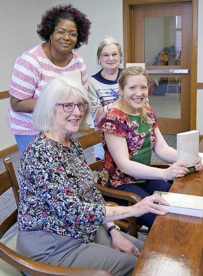 """Group book discussion of """"Evicted: Poverty and Profit in the American City"""" with from left front: Peggy Greenwood, Rev. Laura Martin, Elaine Eder, and Easterlyn Walters."""