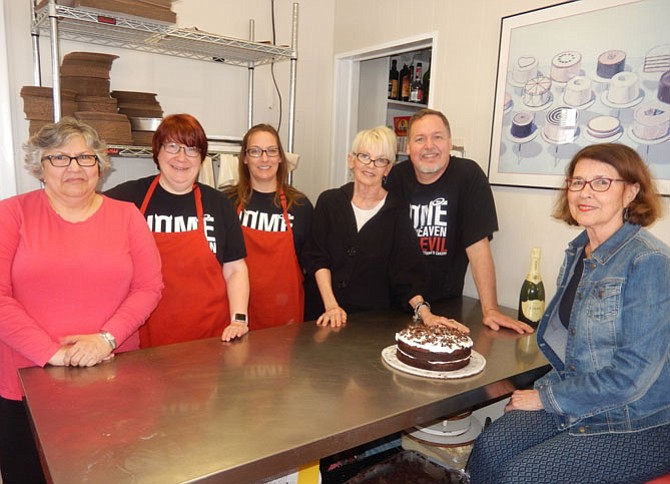 (From left) are Angela Wijas; Ruthie Evers; Gina Bonney; Victoria's Cakery founder Victoria Eustice; her son and the shop's owner since 2001, Mike Hensley; and Linda Campbell.