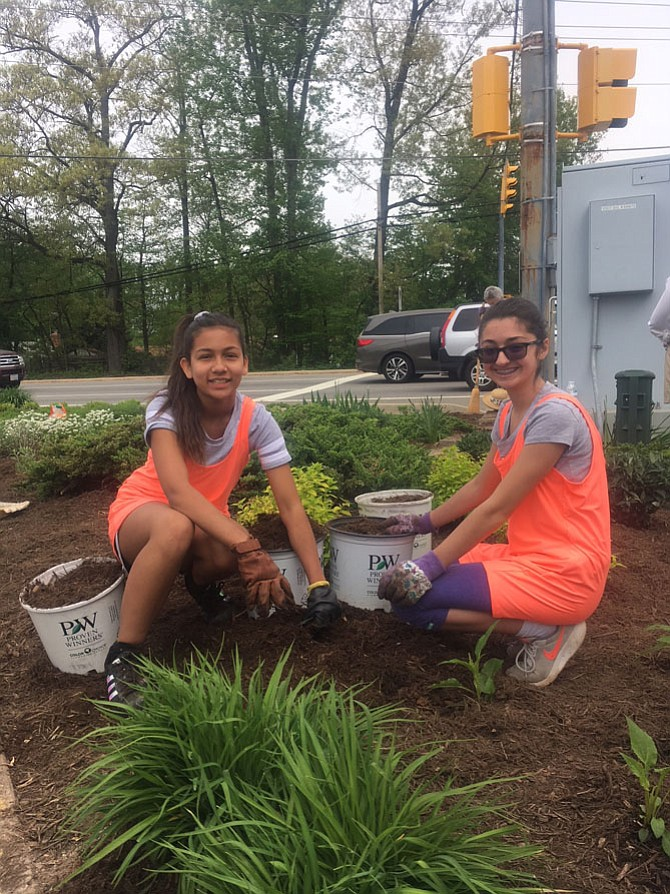 Kylie Mchale, 12, and Meena Lane, 11, from Girl Scout troop 5548 in Springfield doing their part to beautify the triangular island at Sydenstricker Road and Old Keene Mill Road in Burke.