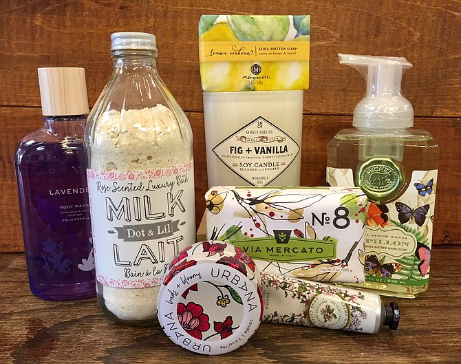 Candles, soaps and lotions in a gift bag will make luxurious end-of-year teacher gifts, says Courtney Thomas of The Picket Fence in Burke.