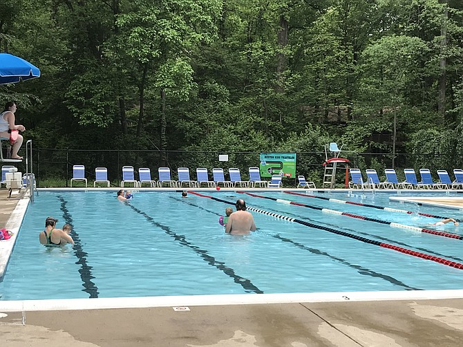 Ridge Heights Heated Pool in Reston opened Saturday, May 12, 2018. Many families enjoyed early evening swims on Monday, May, 14.