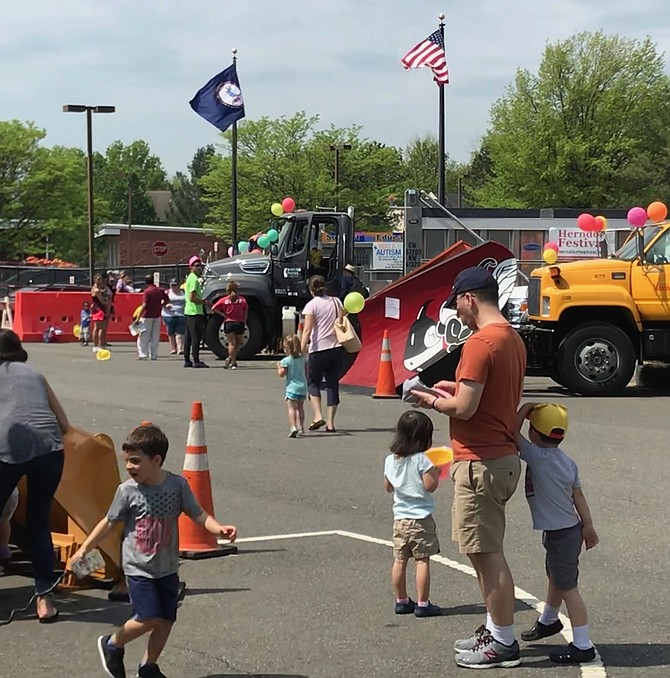 Parents, grandparents and children enjoy a day with the monster machines of the Town of Herndon Department of Public Works at Big Truck Days 2018. Attendees at the event donated approximately 150-200 bags of food to LINK to benefit those in need in the area.
