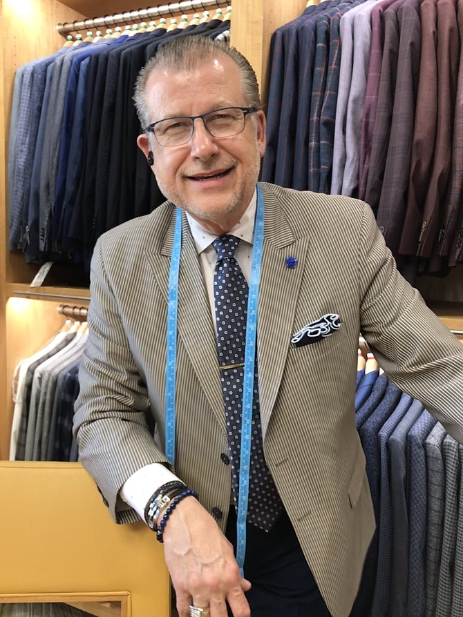 "David A. Eisele Sr., owner of Davelle Clothiers at 11904 Market Street, Reston. In operation 26 years, the business offers high-quality, cutting-edge designs with impeccable fit and focus on the customer paramount. ""There is no other like it anywhere,"" says the owner, David A. Eisele Sr."