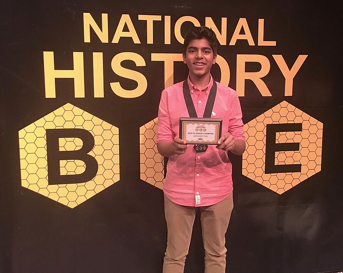 Aaron Joy — a Nysmith School seventh grader from Herndon — holds the certificate documenting his winning a third consecutive National History Bee Regional Championship, a victory that earned him a spot in next month's National Championship event in Atlanta.