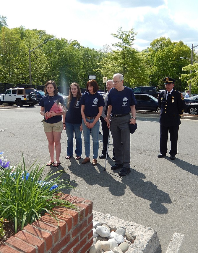 Standing in front of MPO Mike Garbarino's memorial are (from left) his daughters Natalie and Katie; widow Sue Garbarino Woods; Police Chief Ed Roessler; Woods's brother, Peter Brinko, and Capt. Dean Lay.