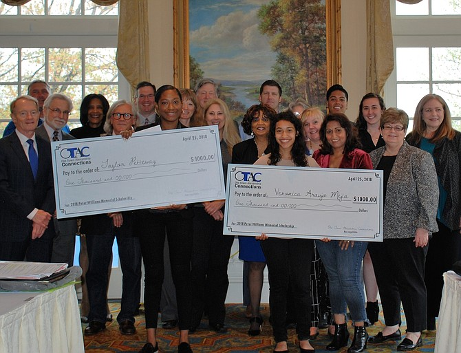 West Potomac High School senior Taylor Petteway and T.C. Williams High School senior Veronica Araujo each holds a check for $1,000 at the presentation of the Peter Williams Memorial Scholarship during the April 25 Old Town Alexandria Connections meeting at Belle Haven Country Club. With them are Araujo's mother Alicia Mejia and members of the OTAC business organization.
