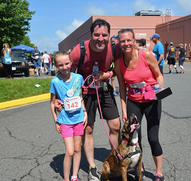 "The Smyth family from Fairfax, Sean, Amy and daughter Malana, finished the 5k benefit race with HART adoptee Lily. ""She was awful,"" joked Sean. ""I know I could have won without her!"""