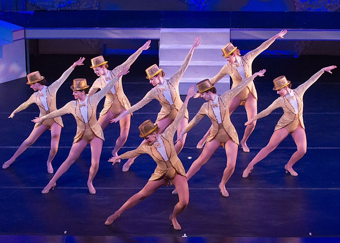 "Dancers performing the iconic number, ""One,"" from ""A Chorus Line."""