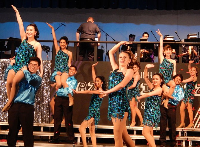 "The ShowStoppers perform ""Conga Rhythm"" in the finale of the May 4-5 Jazz & Pizzazz extravaganza."