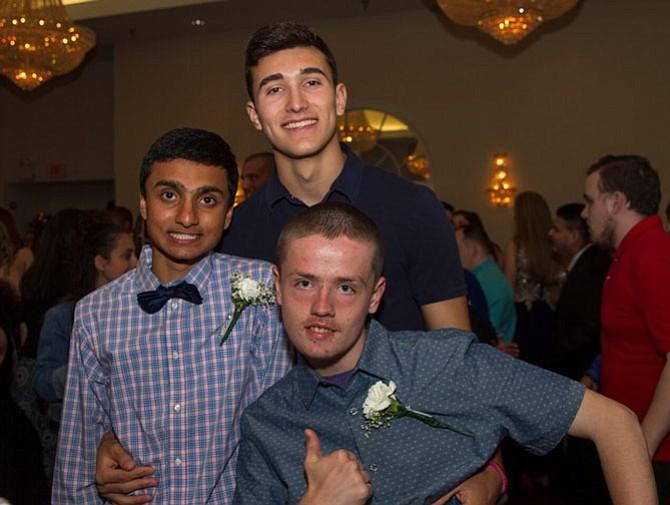 Oakton students, from left:  junior Tarun Ramesh, senior peer buddy Paul Campo, and junior Nick Donner.