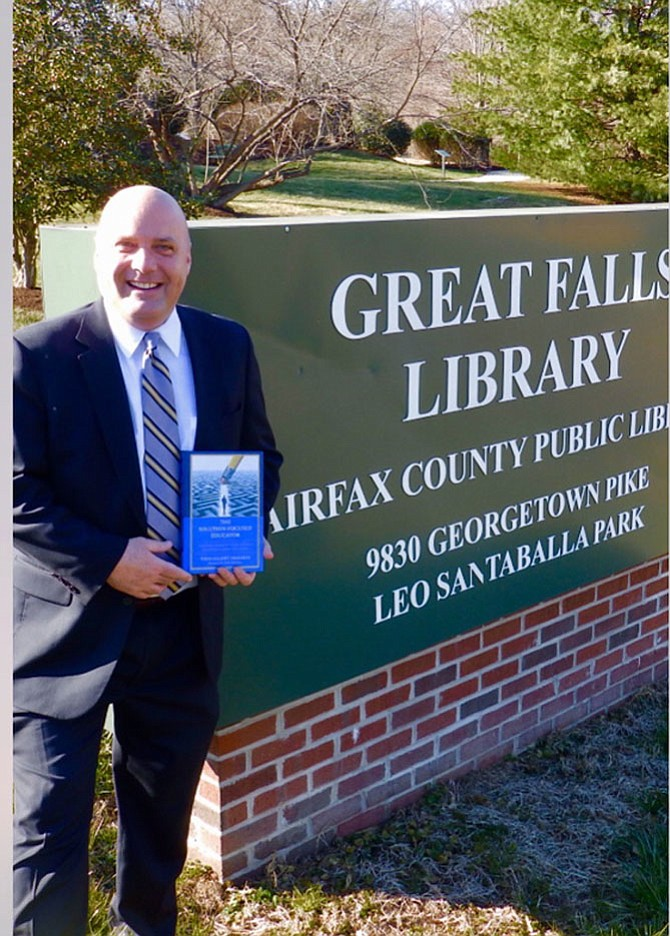 Forestville Elementary Principal Todd Franklin with his book at the Great Falls Library.