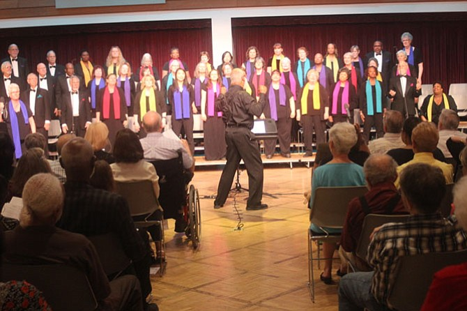 "The Mosaic Harmony Community Choir performs their uplifting and inspirational ""music to unite us"" at a recent concert."