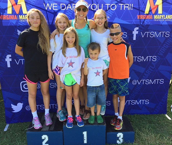Rachel McCarthy of Vienna has her own personal cheering section with her six children when she competes. McCarthy was selected as an Ambassador for the sport of triathlon by USA Triathlon, the sport's governing body.