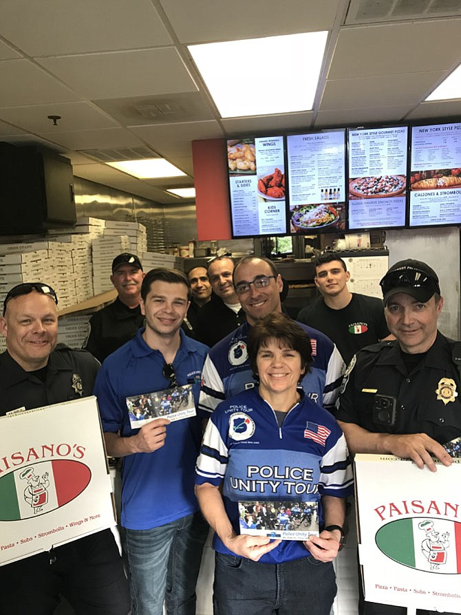 Town of Herndon Chief of Police, Maggie A. DeBoard (center) is joined by (second row) Officer Ron Eicke, Andy DeBoard, Sgt. Bobby Galpin, (third row) Officer Eddie Stapleton,  Amir Bastawrous, Pierre Chahine, owner of Paisano's and Charbel Chahine during the Herndon Paisano's  Blue Friday fundraiser to support the 2018 Police Unity Ride.