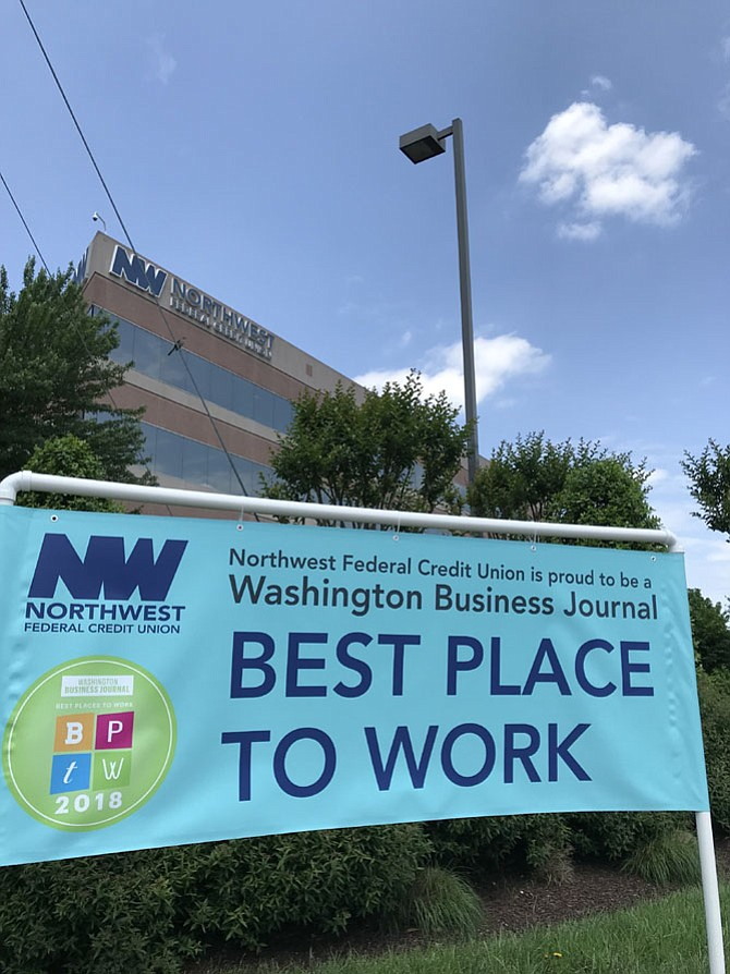 NWFCU announces Washington Business Journal selected the Herndon headquartered financial institution as one of the Best Places to Work. The banner is located in front of their campus at the corner of Herndon Parkway and Spring Street in the Town of Herndon.