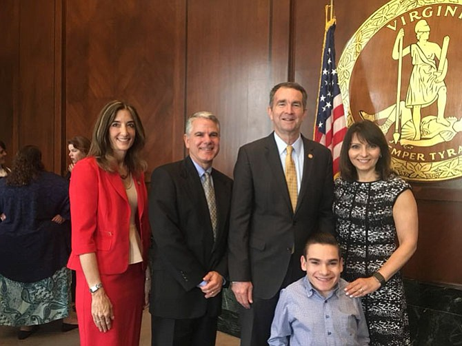 Del. Filler-Corn, Governor Ralph  Northam and the Farbstein family at the signing ceremony for Filler-Corn's bill.
