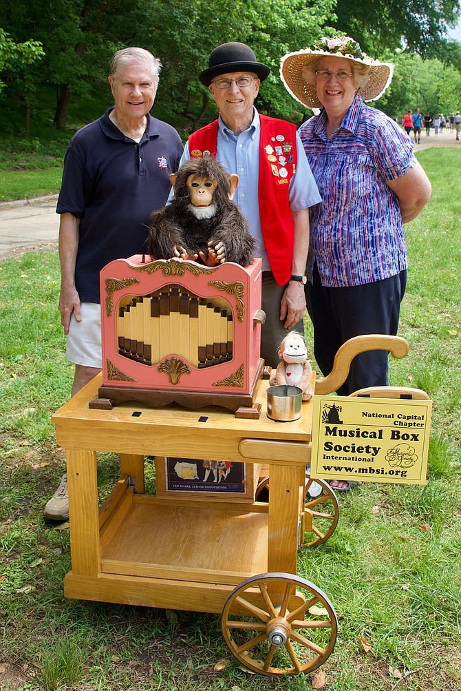 Knowles Little; Paul Senger, president of the The National Capital Chapter of Musical Box Society International; and Virginia Little at Great Falls Tavern on Sunday, May 27. They were demonstrating music boxes, a historic type of entertainment.