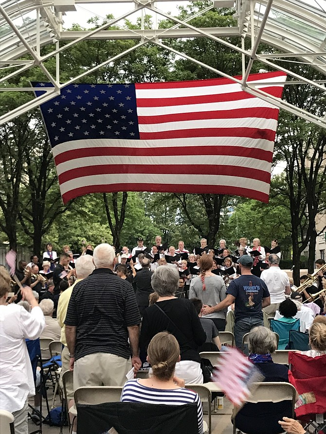 "Members of the Armed Forces stand and wave their flags when they hear the song of their branch of the service during the  ""A Star-Spangled Salute"" held at Reston Town Center over Memorial Day weekend 2018."