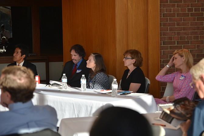 Quizzing the candidates at the Economic Equality Caucus at Lutheran Church of the Redeemer in McLean. From left: Walter Tejada, president Virginia Latino Leaders Council; caucus co-chair Lee Powell; Deanna Heier, Social Concerns Committee chair at Lutheran Church of the Redeemer; Eileen Ellsworth, CEO, Community Foundation of Northern Virginia; and Megan Malone, Board of Trustees member, Phillips Programs for Children and Families.