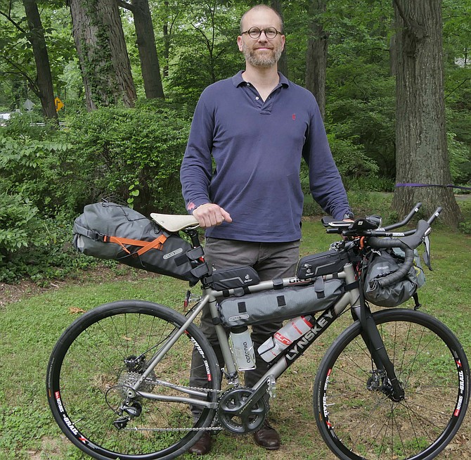 Bruno Dedet has his bike outfitted for the Trans America Bike Race which began June 2 in Astoria, Ore.