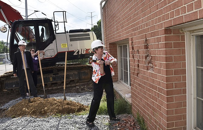 Former state Sen. Mary Margaret Whipple takes a whack at the wall of the Berkeley during the Knock Down event May 31.