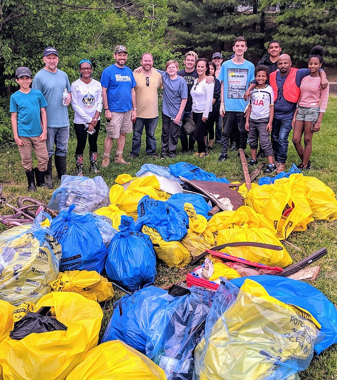 More than 35 volunteers turned out to collect over 2,000 pounds of trash out of Little Hunting Creek.
