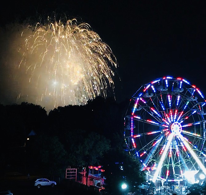 "At least the rain momentarily stopped on Saturday night, and the fireworks lit up the sky. The fireworks were choreographed to music. Songs such as ""My Little Town"" rang loud and clear, stirring the hearts of festival goers."