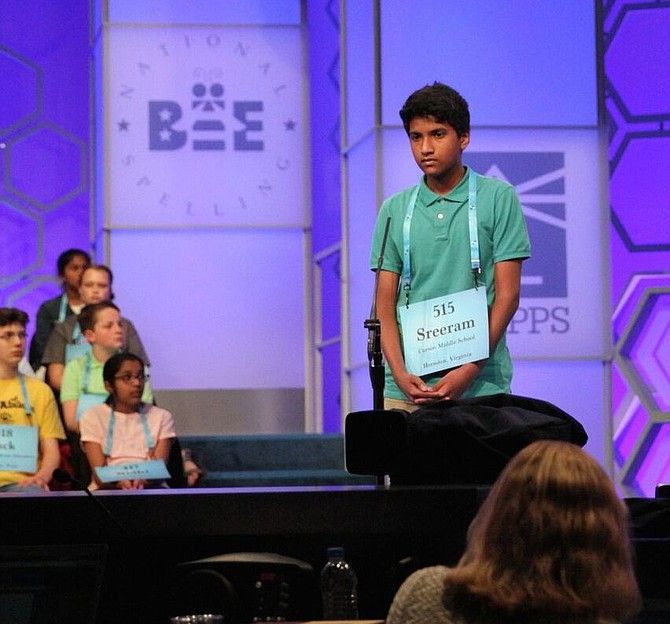 "Eighth-grader Sreeram Pillai of Herndon listens as background information is given for the word ""forastero"" on May 29 at the Scripps National Spelling Bee."