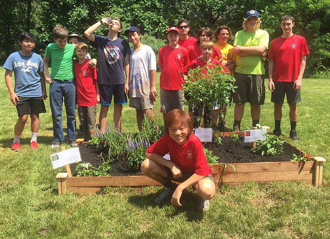Thirty scout and parent volunteers helped install a learning and butterfly garden for Forestville Elementary School.