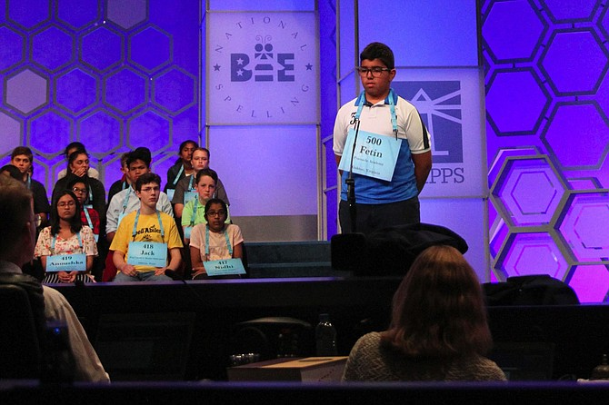 "Fetin Hussain thinks over how to spell ""wisent"" in round two of the Scripps National Spelling Bee on May 29."