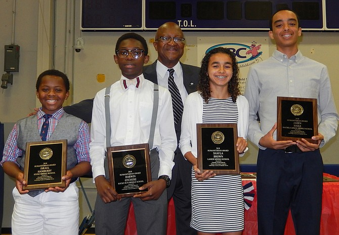 Pictured with CPMSAC President Johnny Nelson (center) are (from left) Israel Hanberry, Stone Middle, seventh grade; Darwin Otchere, Rocky Run, eighth grade; Shayla Brown; and Jaden Haile, Rachel Carson, eighth grade.
