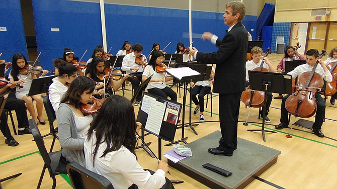 Keith McElroy, Director of the Key Middle School Orchestra, leads students in the Spring Concert on Tuesday, May 29, at the school.